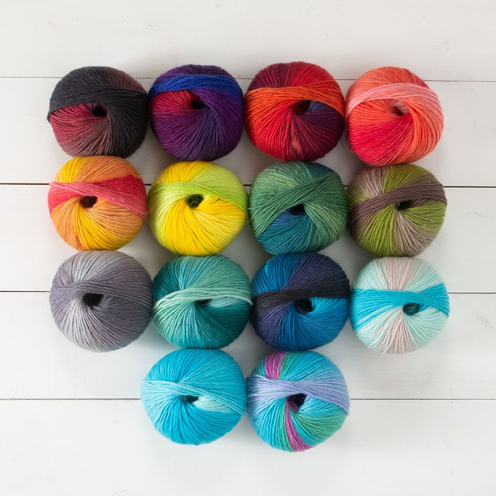 14 balls of Chroma Worsted yarn in various colors