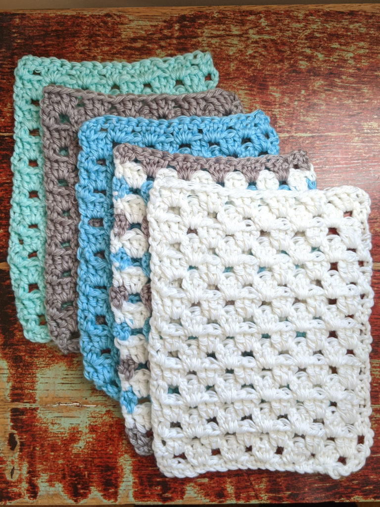 5 rectangles of crochet in the granny stitch in a range of blue and white colors