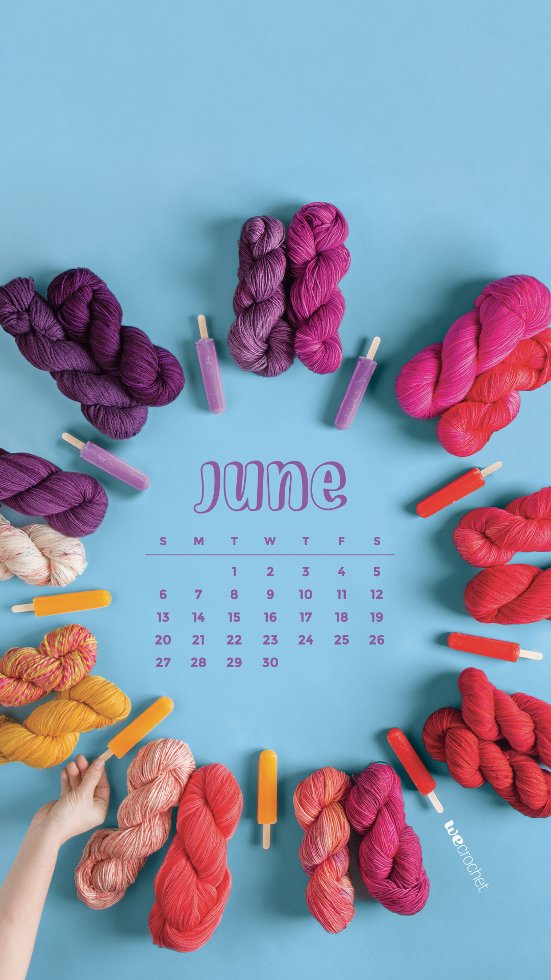 On a blue background, a ring of colorful yarn ranging from purple to pink to red to orange along with matching popsicles. A June 2021 calendar in the center of the circle.
